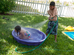 Wordless Wednesday: Wet Summer Siblings Thumbnail