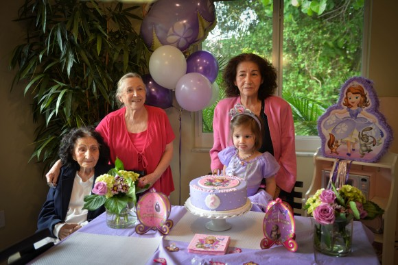 My aunts Millin and Mercedes join in their own cake photo with abuela Micaela and Naomi.